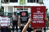 Aksi Tutup Mulut Jurnalis di Medan