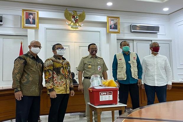 REAL Repower Asia Salurkan APD Senilai Rp1 Miliar ke Pemprov DKI...