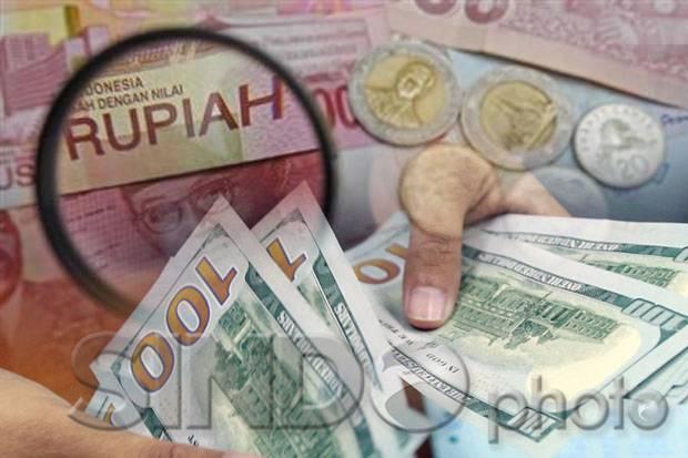 Rupiah Jelang Akhir Pekan Diperkirakan Bergerak Menuju Level Rp14.200/USD