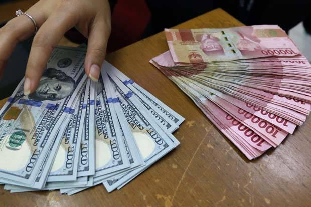 Rupiah Pulang Alami Kerugian ke Rp14.265 per USD