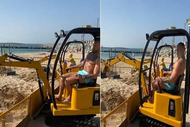 Dasar Conor McGregor! Kalah KO, Malah Asyik Main Ekskavator di Pantai