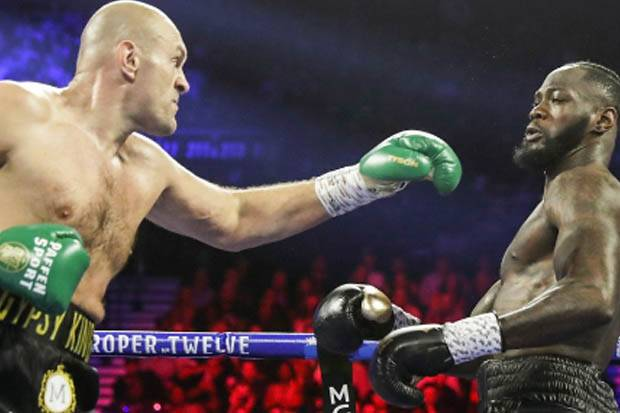 Tyson Fury Sesumbar Robohkan Wilder Lebih Cepat dari Duel Sebelumnya