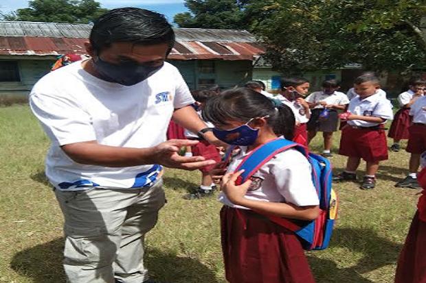 Semangati Siswa Ikut PTM, PT STP Bagikan Masker dan Tas Sekolah